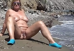 Sexy BBW Nude Chrissy is posing in the sea and walking along-shore