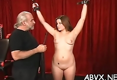 Young babe endures harsh treatment on her muff and tits